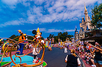 Mickey Mouse, Goofy and other Disney characters on parade near the Cinderella Castle in the Magic Kingdom, Walt Disney World, Orlando, Florida USA