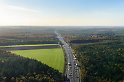 Nederland, Gelderland, Ede, 24-10-2013. Avondspits begint in de namiddag op autosnelweg A12 tussen Ede en Arnhem en doorkruist de bossen in herfstkleuren van de Veluwe.<br /> Traffic in autumn in central Netherlands, on motorway A12 between woods.<br /> luchtfoto (toeslag op standaard tarieven);<br /> aerial photo (additional fee required);<br /> copyright foto/photo Siebe Swart.