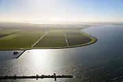 Nederland, Flevoland, Gemeente Almere, 24-10-2013; Almere-Pampus, Kustzone Almere. Zicht op Muiderhoek, locatie voor een mogelijke IJmeerverbinding (IJmeerlijn). Foto richting Almere-Stad en Gooimeer. Pampushaven in de voorgrond.<br /> Windmills along the coast in Almere Poort, viewed in direction Almere-Stad.<br /> luchtfoto (toeslag op standaard tarieven);<br /> aerial photo (additional fee required);<br /> copyright foto/photo Siebe Swart.