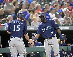 September 13, 2017 - Arlington, TX, USA - The Seattle Mariners' Kyle Seager (15) is congratulated by teammate Guillermo Heredia (5) after scoring on a Nelson Cruz fly out in the seventh inning at Globe Life Park in Arlington, Texas, on Wednesday, Sept. 13, 2017. (Credit Image: © Max Faulkner/TNS via ZUMA Wire)