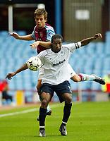 Photograph: Scott Heavey.<br />Aston Villa v Blackburn Rovers. FA Baclaycard Premiership. 05/10/2003.<br />Lee Hendry (Behind) climbs over Jay Jay Okacha