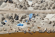 Pirogues and salt production on the shore of Lac Rose (Pink Lake) near Dakar, Senegal.