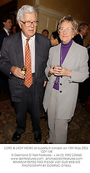 LORD & LADY HOWE at a party in London on 13th May 2002.OZY 138