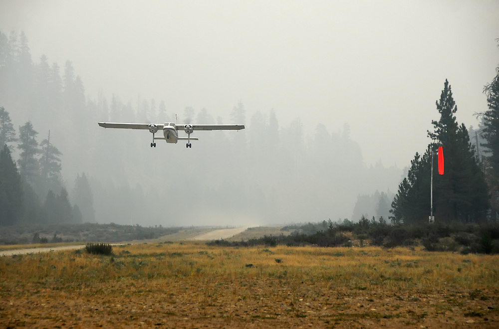 Britten-Norman Islander taking off from the Indian Creek airstrip in Idaho's Frank Church - River of No Return Wilderness.  The haze in the air is smoke from nearby forest fires.