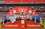 Lincoln City celebrate winning the Checkatrade Trophy during the EFL Trophy Final match between Lincoln City and Shrewsbury Town at Wembley Stadium, London, England on 8 April 2018. Picture by Stephen Wright.