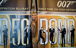 © Licensed to London News Pictures. 24/09/2012. LONDON, UK. Actress Britt Ekland, who played Bond Girl 'Goodnight' in 'The Man with the Golden Gun' is seen peeking through curtains inside HMV's Oxford Street store in London, today (24/09/12) during a photocall. The stars were in London during the final leg of a UK tour to promote the Bond 50 Blu-Ray collection.  Photo credit: Matt Cetti-Roberts/LNP