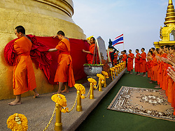 November 15, 2018 - Bangkok, Bangkok, Thailand - Monks wrap the chedi at the top of Wat Saket, also called the Golden Mount, during the red cloth ceremony. Wat Saket is on a man-made hill in the historic section of Bangkok. The temple has golden spire that is 260 feet high, which was the highest point in Bangkok for more than 100 years. The temple construction began in the 1800s during the reign of King Rama III and was completed in the reign of King Rama IV. A  red cloth (reminiscent of a monk's robe) is placed around the chedi at the top of  Golden Mount during the weeks leading up to the Thai holy day of Loy Krathong, which is November 22 this year. (Credit Image: © Sean Edison/ZUMA Wire)