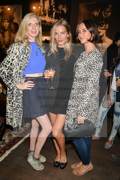 Left to right, DANIELLA FELDER, SILJE VALLEVIK and LAUREN MEZZINA at a private view of photographs by Marc Lagrange at Heist, 43 Linden Gardens, London on 2nd October 2014.