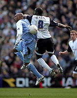 Photo: Paul Thomas.<br /> Preston North End v Manchester City. The FA Cup. 18/02/2007.<br /> <br /> Ousmane Dabo (L) of Man City gets an elbow in the head from Michael Ricketts.