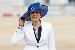 © Licensed to London News Pictures. 12/07/2017. London, UK. UK Prime Minister Theresa May laughs as Home Secretary Amber Rudd's hat flew off in the wind on their way to Horse Guards Parade to welcome King Felipe VI and Queen Letizia of Spain in London on the first day of State visit of the King and Queen of Spain. Photo credit: Tolga Akmen/LNP
