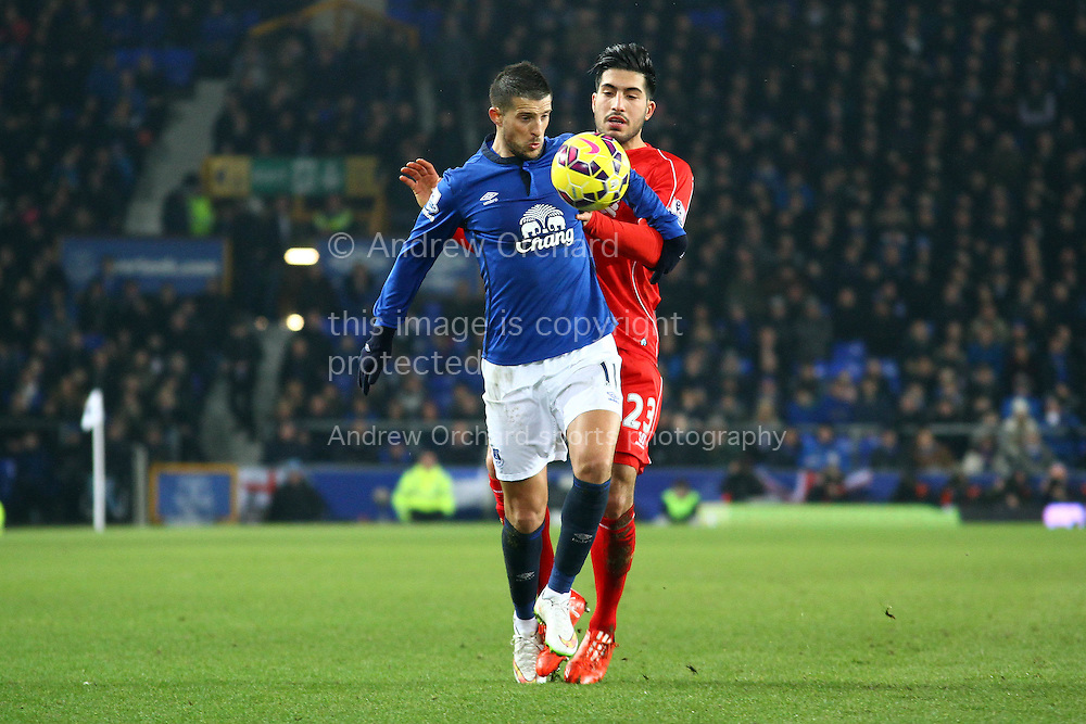 Kevin Mirallas of Everton shields the ball from Emre Can of Liverpool. Barclays Premier league match, Everton v Liverpool at Goodison Park in Liverpool, Merseyside on Saturday 7th February 2015<br /> pic by Chris Stading, Andrew Orchard sports photography.
