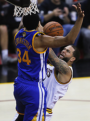 June 9, 2017 - Cleveland, OH, USA - The Cleveland Cavaliers' Deron Williams, right, scores against the Golden State Warriors' Shaun Livingston in the third quarter during Game 4 of the NBA Finals at Quicken Loans Arena in Cleveland on Friday, June 9, 2017. The Cavs won, 137-116, trimming their series deficit to 3-1. (Credit Image: © Leah Klafczynski/TNS via ZUMA Wire)