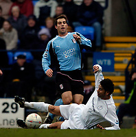 Photo. Jed Wee.<br /> Bolton Wanderers v Fulham, FA Cup 5th Round, 19/02/2005.<br /> Fulham's Carlos Bocanegra is denied by a sliding tackle from Bolton's Fernando Hierro.
