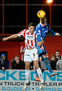 Ryan Taylor beats Troy Brown to the ball during the Sky Bet League 2 match between Cheltenham Town and Portsmouth at Whaddon Road, Cheltenham, England on 20 December 2014. Photo by Alan Franklin.