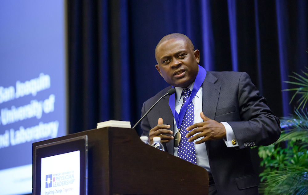 "Dr. Bennet Omalu, the Nigerian forensic pathologist who is featured in ""CONCUSSION"" the book and movie (starring Will Smith)"