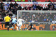 QPR's Bobby Zamora (25) scores his sides only goal past Swansea keeper Michel Vorm.  Barclays Premier league, Swansea city v Queens Park Rangers at the Liberty Stadium in Swansea, South Wales on Saturday  9th Feb 2013. pic by Andrew Orchard, Andrew Orchard sports photography,
