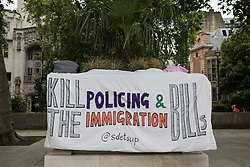 A banner opposing the Police and Immigration Bills is pictured draped on a plinth during a Kill The Bill protest in Parliament Square on 5th July 2021 in London, United Kingdom. The Police, Crime, Sentencing and Courts (PCSC) Bill 2021, which was being debated in the Houses of Parliament, would grant the police a range of new discretionary powers to shut down protests, including the ability to impose conditions on any protest deemed to be disruptive to the local community, wider stop and search powers and sentences of up to 10 years in prison for damaging memorials.