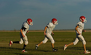 11/7/07 Smith Center, KS.The Smith Center High School football team runs at practice..Smith Center Kansas is seems like it is in the middle of nowhere, when in reality it isn't that far from the Geographic Center of the lower 48 States...(Chris Machian/Prairie Pixel Group)