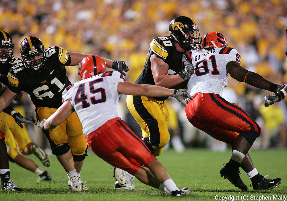 08 SEPTEMBER 2007: Iowa center Travis Meade (61) and Iowa offensive tackle Kyle Calloway (60) in Iowa's 35-0 win over Syracuse at Kinnick Stadium in Iowa City, Iowa on September 8, 2007.