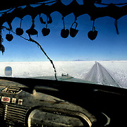 Cabin  truck.  Salar de Uyuni ( Uyuni salt flat ) . Department  of Potosí  ( Los Lipez).  South West  Bolivia. <br /> Adult Altiplano America Andes Arid  Aridity  Barren  Bolivia Cabin Color Colour  Day Daytime Decoration  Department  Desert Desolate Desolation Dry  Exterior Extraction  Geography Hack Hard  Heat Highlands  Horizon Horizontal Human  Latin America Lake  Los Lipez Lorry Miner Mining Nature  Resource Road  Natural  One Outdoors Outside  Pan  Potosí  Production  Region Resource Rural Salar de Uyuni  Salt Flat  Salt Pan  Salt lake  Scenic Seasoning  Single Shape South America  Southwest  Sud Sunglasses  Surface Track Travel  Way West White