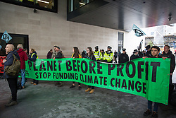 London, UK. 11 October, 2019. Climate activists from Extinction Rebellion protest outside the BBC's New Broadcasting House on the fifth day of International Rebellion protests. They were demanding that the broadcaster 'tell the truth' regarding the climate emergency.