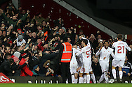 Philippe Coutinho of Liverpool celebrates with his teammates towards the Liverpool away fans after scoring his teams 1st goal of the match from a free kick to make it 1-1. The Emirates FA cup, 4th round replay match, West Ham Utd v Liverpool at the Boleyn Ground, Upton Park  in London on Tuesday 9th February 2016.<br /> pic by John Patrick Fletcher, Andrew Orchard sports photography.