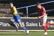 Toby Stevenson of Charlton Athletic (43)) chases Tyler Walker of Mansfield Town (19) down the wing during the The FA Cup match between Mansfield Town and Charlton Athletic at the One Call Stadium, Mansfield, England on 11 November 2018.