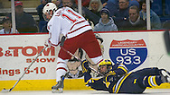 17 Feb 2006 Omaha, NE University of Nebraska at Omah's Mike Lefley tries to advance the puck while  University of Michigan's T.J. Hensick tries to slow him down with his stick Friday night at Omaha Civic Auditorium..(Photo by Chris Machian/Prarie Pixel Group).