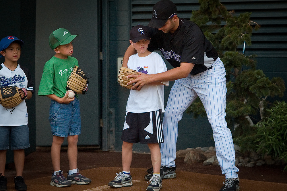 Members of the Rockies Rookies Kids Club of the Colorado Rockies Major League Baseball team gather yearly at Coors Field for a free Back-To-Basics Clinic to develop their skills.