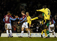 Fotball<br /> England 2004/22005<br /> Foto: SBI/Digitalsport<br /> NORWAY ONLY<br /> <br /> Burnley v Liverpool<br /> FA Cup 3rd Round, 18/01/2005.<br /> <br /> Burnley celebrate following Djimi Traore's (R) own goal, as he kicks out in frustration.
