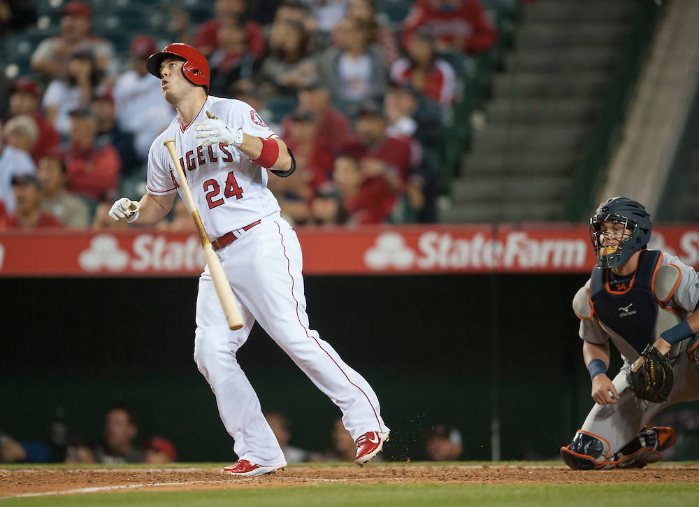 The Angels' C.J. Cron watches his walk-off home run in the ninth inning during the Angels' 11-9 victory over the Detroit Tigers Tuesday at Angel Stadium.<br /> <br /> ///ADDITIONAL INFO:   <br /> <br /> angels.0531.kjs  ---  Photo by KEVIN SULLIVAN / Orange County Register  -- 5/31/16<br /> <br /> The Los Angeles Angels take on the Detroit Tigers Tuesday at Angel Stadium.