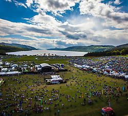 """The view from the Giant Wheel, overlooking the main stage and campsite area. Saturday at Rockness 2013, the annual music festival which took place in Scotland at Clune Farm, Dores, on the banks of Loch Ness, near Inverness in the Scottish Highlands. The festival is known as """"the most beautiful festival in the world"""" ."""