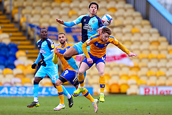 Kyle Knoyle of Cambridge United and George Maris of Mansfield Town jump to head the ball - Mandatory by-line: Ryan Crockett/JMP - 20/02/2021 - FOOTBALL - One Call Stadium - Mansfield, England - Mansfield Town v Cambridge United - Sky Bet League Two