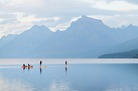 Kayakers and paddle boarding on Lake McDonald Glacier National Park