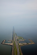 Nederland, Friesland, Gemeente Wonseradeel, 28-04-2010; Afsluitdijk ter hoogte van Breezanddijk, (voormalig werkeiland Breezand). Gezien naar de Friese kust, IJsselmeer  (r), Waddenzee (li)..Enclosure Dam at the height of Breezanddijk (former 'work island' Breezand), seen in the direction of the Frisian coast, IJsselmeer lake (r), the Wadden Sea (l)..luchtfoto (toeslag), aerial photo (additional fee required).foto/photo Siebe Swart