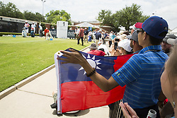 May 26, 2019 - Fort Worth, TX, USA - A fan holds up a Taiwanese flag for C. T. Pan of Taiwan as Pan begins the final round of the 2019 Charles Schwab Challenge PGA at Colonial Country Club. (Credit Image: © Erich Schlegel/ZUMA Wire)