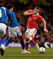 Photo: Leigh Quinnell.<br /> Wales v Paraguay. International Friendly. 01/03/2006. Wales' Jason Koumas takes the ball past Paraguays Juan D. Caceres.