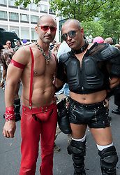 Two men posing at Christopher Street Day Parade in Berlin Germany 2011