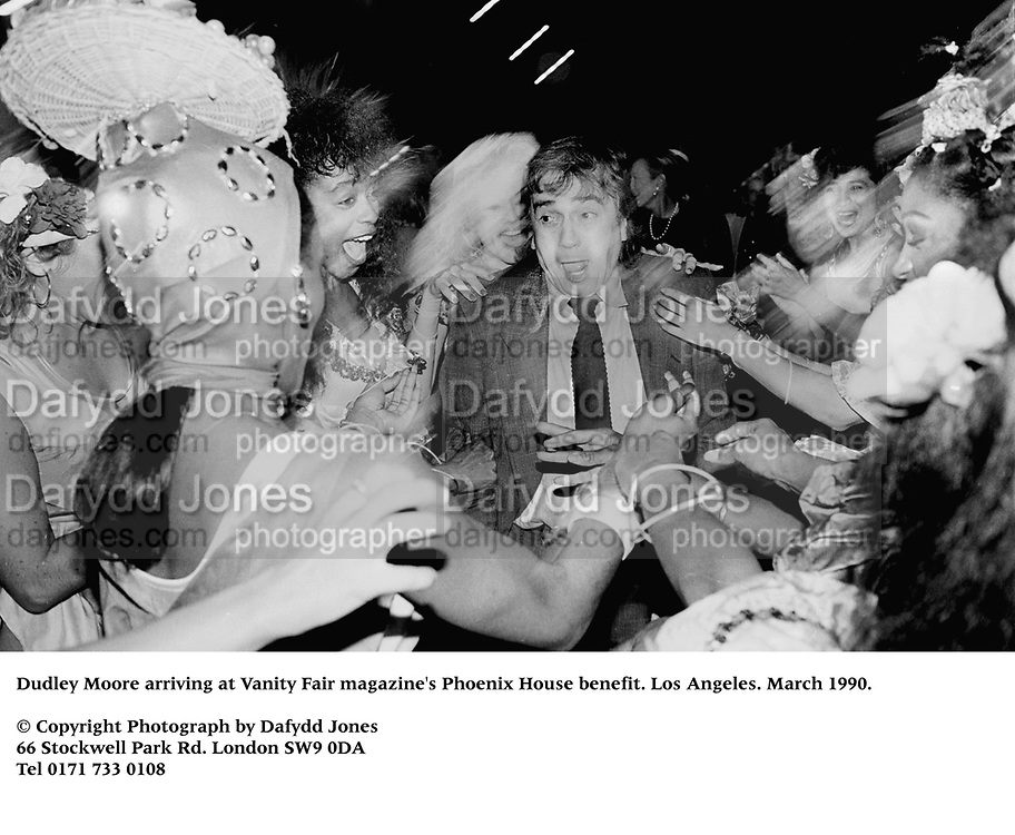 Dudley Moore arriving at Vanity Fair magazine's Phoenix House benefit. Los Angeles. March 1990.<br /><br />© Copyright Photograph by Dafydd Jones<br />66 Stockwell Park Rd. London SW9 0DA<br />Tel 0171 733 0108<br />Film.90199/26