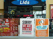 """11 JUNE 2020 - WEST DES MOINES: A closed """"bubble tea"""" stand in Jordan Creek Mall with a baseball hat shop behind it. Jordan Creek Mall in West Des Moines is still nearly empty  after it reopened about two weeks ago. Many stores are still closed, the food court is still closed, and many of the restaurants are closed.         PHOTO BY JACK KURTZ"""