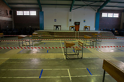 Learners desks are used to create social distancing lines leading to the main hall where students will be screened for COVID-19 systoms each morning when they return to Stellenzicht Secondary School, in Jamestown, Stellenbosch. The school remained closed on Monday, June 1st, 2020, the day the South African government had originally said schools would open for grade 7 and grade 12 learners. Many schools in the Western Cape opened their doors to students on Monday, despite the national government's last minute delay of the school start to June 8, for higher COVID-19 readiness. The province is now facing legal action from the SA Human Rights Commission for the decision to open schools on June 1st. PHOTO: EVA-LOTTA JANSSON