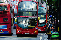 © Licensed to London News Pictures. 21/06/2012. London, UK.  Oxford Street is heavily congested with buses during rush hour the day before the London bus strike.  17 bus companies engage in a 24 hour strike across London in a dispute over pay during the Olympic period. Photo credit : Richard Isaac//LNP