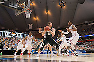 27 MAR 2015: Matt Costello (10) of Michigan State University looks to pass over Buddy Hield (24) of the University of Oklahoma during the 2015 NCAA Men's Basketball Tournament held at the Carrier Dome in Syracuse, NY. Michigan State defeated Oklahoma 62-58. Brett Wilhelm/NCAA Photos