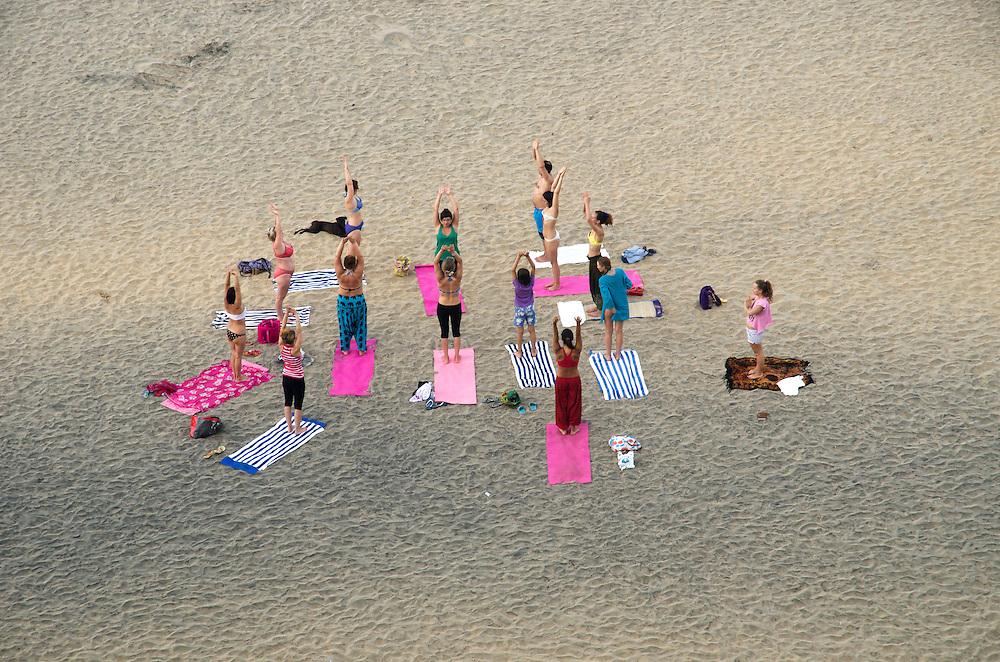 Early morning yoga on Varkala beach, Kerala, Indian Subcontinent