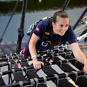 BOSTON -- SEPT 11, 2019 -- Chief Builder Alicia Baston of Bangor, Maine climbs the main mast rigging aboard USS Constitution as part of heritage training with Greater New England Chiefs Mess. <br />