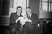 """17/05/1966<br /> 05/17/1966<br /> 17 May 1966<br /> Book reception for """"Decades of Glory: A Comprehensive History of the National Game"""" by Raymond Smith.<br /> This reception was held in the offices of W.D. & H.O. Wills to honour the well known author and journalist, Raymond Smith. His book on the history of Hurling (""""Decades of Glory"""") has just been published with the assistance of Wills of Dublin and Cork and the Central Council of the G.A.A.<br /> Author, Raymond Smith (left) with Frank Burke."""