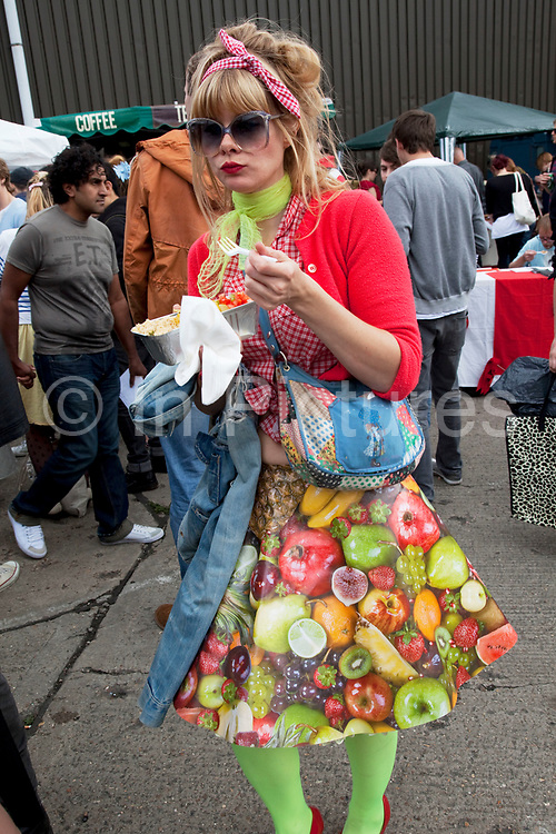 Fruit fashion. The Art Car Boot Fair in a car park just off Brick Lane in East London. This is an alternative art event where artists show their works and engage with the public. The Art Car Boot Fair was an idea that grew out of a desire to re-introduce some summer fun and frivolity into a thriving but increasingly commercial London art scene. The aim for the Art Car Boot Fair is to be a day when the artists let their hair down and for all-comers to engage with art in a totally informal way, and to pick up some real art bargains.