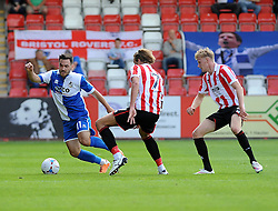 Jake Gosling of Bristol Rovers is challenged by Harry Pell of Cheltenham Town - Mandatory by-line: Neil Brookman/JMP - 25/07/2015 - SPORT - FOOTBALL - Cheltenham Town,England - Whaddon Road - Cheltenham Town v Bristol Rovers - Pre-Season Friendly