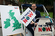 Darren Jones, Labour MP sits in a rickshaw at a climate change protest in Westminster, Central London, United Kingdom on 26th June 2019. Organisers of the Time is Now mass lobby demand politicians end the UKs contribution to climate change.