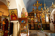 Interior of St Georges  traditional Greek Orthodox church, Mykonos, Cyclades Islands, Greece. .<br /> <br /> Visit our GREEK HISTORIC PLACES PHOTO COLLECTIONS for more photos to download or buy as wall art prints https://funkystock.photoshelter.com/gallery-collection/Pictures-Images-of-Greece-Photos-of-Greek-Historic-Landmark-Sites/C0000w6e8OkknEb8